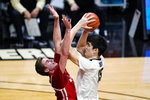 Purdue center Zach Edey (15) shoots over Wisconsin forward Nate Reuvers (35) during the second half of an NCAA college basketball game in West Lafayette, Ind., Tuesday, March 2, 2021. (AP Photo/Michael Conroy)