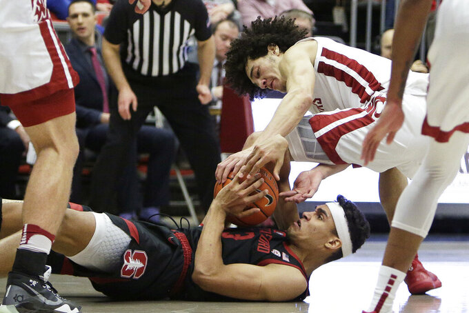 Stanford forward Oscar da Silva, bottom, and Washington State forward CJ Elleby try and gain possession of the ball during the second half of an NCAA college basketball game in Pullman, Wash., Sunday, Feb. 23, 2020. Stanford won 75-57. (AP Photo/Young Kwak)