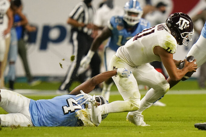 North Carolina defensive back Trey Morrison (4) sacks Texas A&M quarterback Kellen Mond (11) during the first half of the Orange Bowl NCAA college football game Saturday, Jan. 2, 2021, in Miami Gardens, Fla. (AP Photo/Lynne Sladky)