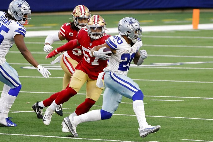 Dallas Cowboys running back Tony Pollard (20) sprints past San Francisco 49ers linebacker Dre Greenlaw (57) and Fred Warner, rear, on his way to the end zone for a touchdown in the second half of an NFL football game in Arlington, Texas, Sunday, Dec. 20, 2020. (AP Photo/Michael Ainsworth)