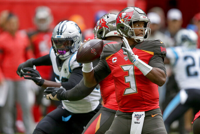Tampa Bay Buccaneers quarterback Jameis Winston (3) passes against the Carolina Panthers during the second quarter of an NFL football game, Sunday, Oct. 13, 2019, at Tottenham Hotspur Stadium in London. (AP Photo/Tim Ireland)