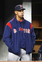 Boston Red Sox manager Alex Cora watches from the dugout steps during the ninth inning of a baseball game, Wednesday, April 17, 2019, in New York as the Yankees defeated the Red Sox 5-3.  (AP Photo/Kathy Willens)