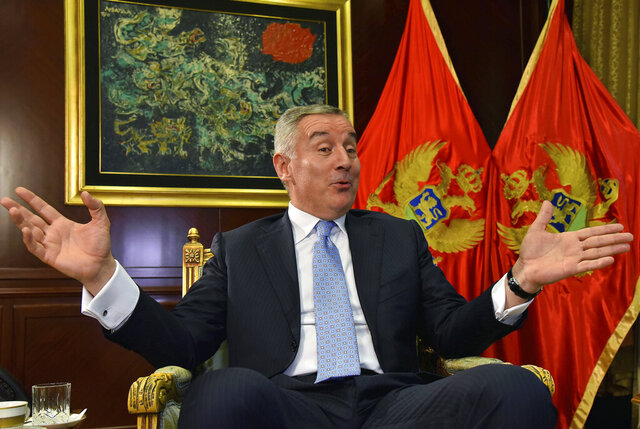 FILE - In this Thursday, April 4, 2019 file photo, Montenegro President Milo Djukanovic speaks and gestures during an interview to The Associated Press in Montenegro's capital Podgorica. Montenegro's president says the upcoming parliamentary vote is crucial in the defense of the small Balkan country's independence in the face of renewed attempts from Serbia and Russia to install their nationalist and anti-Western allies to power. (AP Photo/Risto Bozovic, File)