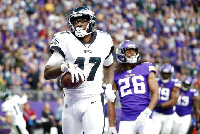 Philadelphia Eagles wide receiver Alshon Jeffery catches a 3-yard touchdown pass ahead of Minnesota Vikings cornerback Trae Waynes (26) during the second half of an NFL football game, Sunday, Oct. 13, 2019, in Minneapolis. (AP Photo/Bruce Kluckhohn)