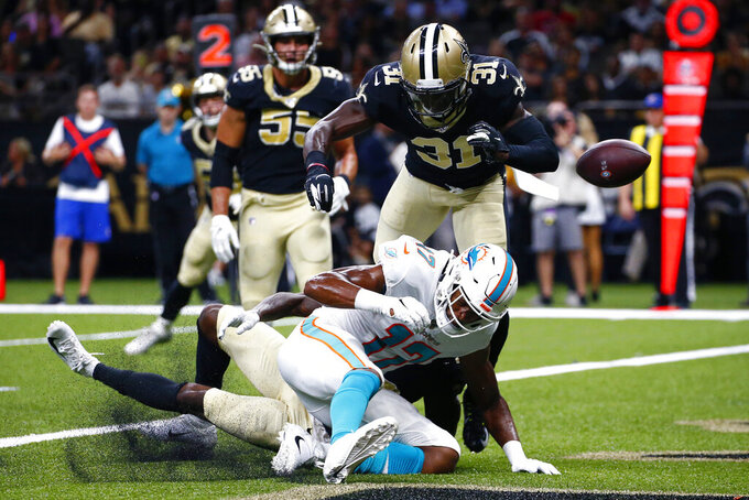 New Orleans Saints defensive back Chris Banjo (31) and cornerback Ken Crawley break up a pass in the end zone intended for Miami Dolphins wide receiver Brice Butler (17) in the first half of an NFL preseason football game in New Orleans, Thursday, Aug. 29, 2019. (AP Photo/Butch Dill)