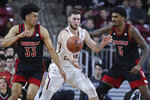 Boston College forward Nik Popovic, center, is pressured by Louisville's Jordan Nwora (33) and Malik Williams (5) during the first half of an NCAA college basketball game in Boston, Wednesday, Jan. 29, 2020. (AP Photo/Charles Krupa)