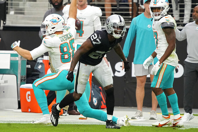 Las Vegas Raiders cornerback Trayvon Mullen (27) reacts after stopping a catch by Miami Dolphins tight end Mike Gesicki (88) during the second half of an NFL football game, Sunday, Sept. 26, 2021, in Las Vegas. (AP Photo/Rick Scuteri)