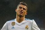 Real Madrid's Cristiano Ronaldo reacts during a Spanish La Liga soccer match between Real Madrid and Villarreal at the Santiago Bernabeu stadium in Madrid, Spain, Saturday, Jan. 13, 2018. (AP Photo/Paul White)