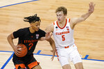 Miami guard Isaiah Wong (2) and Clemson forward Hunter Tyson (5) get tangled during the second half of an NCAA college basketball game in the second round of the Atlantic Coast Conference tournament in Greensboro, N.C., Wednesday, March 10, 2021. (AP Photo/Gerry Broome)