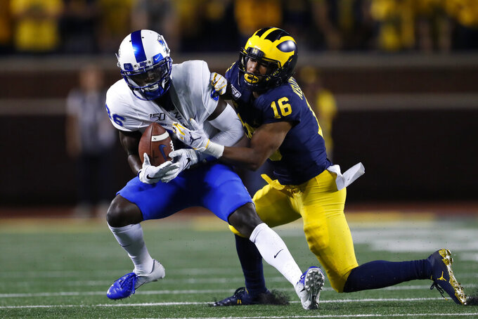 Middle Tennessee wide receiver Jarrin Pierce, left, catches a pass as Michigan defensive back Jaylen Kelly-Powell (16) defends during the second half of an NCAA college football game in Ann Arbor, Mich., Saturday, Aug. 31, 2019. (AP Photo/Paul Sancya)