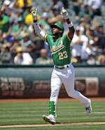 Oakland Athletics' Jurickson Profar celebrates after hitting a two run home run off Seattle Mariners' Erik Swanson in the second inning of a baseball game Wednesday, July 17, 2019, in Oakland, Calif. (AP Photo/Ben Margot)