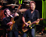 FILE - Bruce Springsteen, right, and Nils Lofgren of the E Street Band perform during their concert at the Los Angeles Sports Arena on Oct. 29, 2007. Springsteen's latest album,
