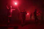In this Monday, Sept. 9, 2019 photo, youths, mostly football ultras, light flares in celebration of Ashura, in Sale, near Rabat, Morocco. On Sept. 9, the Arab and Muslim world marked Ashura, a day commemorating the death of Imam Hussein, the grandson of the Prophet Muhammad and one of Shia Islam's most important figures. (AP Photo/Mosa'ab Elshamy)