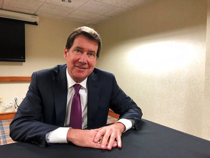 Republican U.S. Senate candidate Bill Hagerty poses for a photo after an Associated Press interview at a regional meeting of the Conservative Political Action Conference Tuesday, Oct. 29, 2019, in Memphis, Tenn. Hagerty is not wavering from his staunch support of President Donald Trump, defending him from Democrats' impeachment efforts while heaping praise on the president for his handling of the economy and the killing of Islamic State leader Abu Bakr al-Baghdadi. (AP Photo/Adrian Sainz)