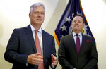 Robert C. O'Brien, left, United States National Security Advisor, and Richard Grenell, right, United States Ambassador to Germany, address the media during a press conference in Berlin, Germany, Monday, Jan. 20, 2020 prior to the signing of an agreement between Kosovo and Serbia, establishing air service between the two capitals. (AP Photo/Michael Sohn)