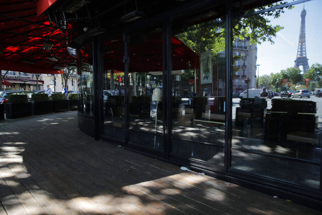 An empty terrace of a restaurant is pictured in Paris, Thursday, May 28, 2020. France is reopening its restaurants, bars and cafes starting next week as the country eases most restrictions amid the coronavirus crisis. Edouard Philippe defended the gradual lifting of lockdown up to now, saying the strategy was meant to avoid provoking a second wave. (AP Photo/Christophe Ena)