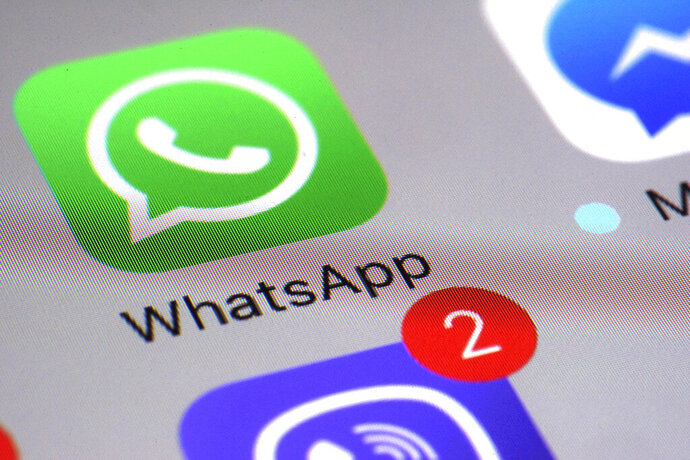 FILE - This Friday, March 10, 2017, file photo shows the WhatsApp communications app on a smartphone, in New York. In early January 2021, encrypted messaging apps Signal and Telegram are seeing huge upticks in downloads from Apple and Google's app stores, while WhatsApp's growth is on the decline following a privacy fiasco where the company was forced to clarify a message it sent to users. (AP Photo/Patrick Sison, File)