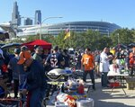 Fans tailgate outside Soldier Field before an NFL football game between the Green Bay Packers and the Chicago Bears Thursday, Sept. 5, 2019, in Chicago. (AP Photo/David Banks)
