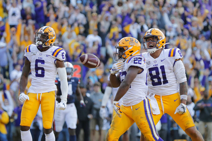 LSU running back Clyde Edwards-Helaire (22) celebrates his touchdown with tight end Thaddeus Moss (81) and wide receiver Terrace Marshall Jr. (6) in the second half of an NCAA college football game against Auburn in Baton Rouge, La., Saturday, Oct. 26, 2019. LSU won 23-20. (AP Photo/Gerald Herbert)