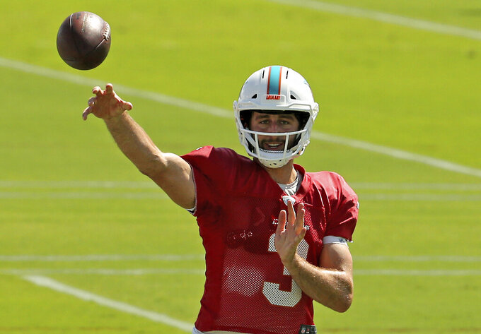 Miami Dolphins quarterback Josh Rosen (3) run drills during practice at the Baptist Health Training Facility at Nova Southeastern University on Wednesday, October 16, 2018, in Davie in preparation for their game against the Buffalo Bills on Sunday at New Era Field in New York.(David Santiago/Miami Herald via AP)