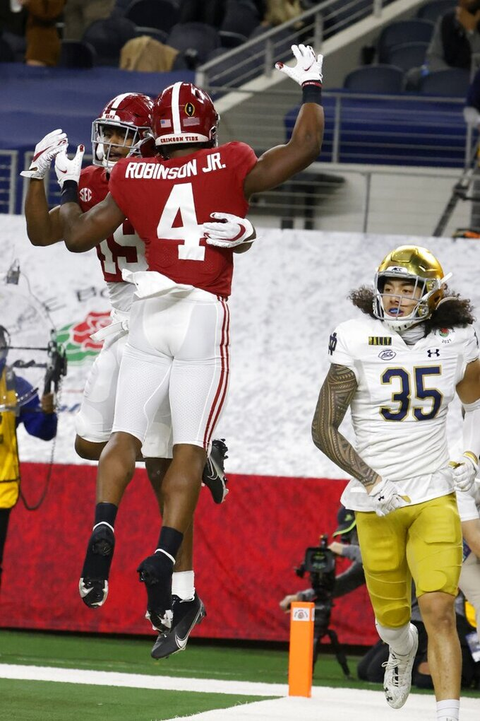 Alabama tight end Jahleel Billingsley (19) and running back Brian Robinson Jr. (4) celebrate a touchdown scored by Billingsley as Notre Dame linebacker Marist Liufau (35) jogs past in the first half of the Rose Bowl NCAA college football game in Arlington, Texas, Friday, Jan. 1, 2021. (AP Photo/Michael Ainsworth)