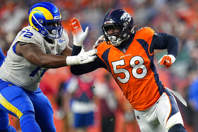 Denver Broncos outside linebacker Von Miller (58) battles Los Angeles Rams offensive guard Tremayne Anchrum (72) during the first half of an NFL preseason football game, Saturday, Aug. 28, 2021, in Denver. (AP Photo/Jack Dempsey)