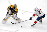 Boston Bruins goaltender Tuukka Rask (40) comes out of the crease to make a stick-save against Florida Panthers center Vincent Trocheck (21) during the third period of an NHL hockey game, Thursday, March 7, 2019, in Boston. (AP Photo/Mary Schwalm)