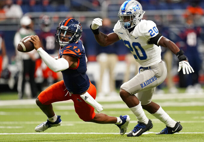 UTSA quarterback Frank Harris, left, is pressured by Middle Tennessee linebacker DQ Thomas (20) during the first half of an NCAA college football game, Friday, Sept. 25, 2020, in San Antonio. (AP Photo/Eric Gay)