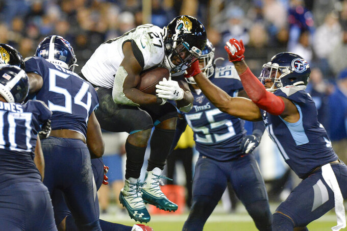 Jacksonville Jaguars running back Leonard Fournette (27) leaps over the goal line as he scores a touchdown on a 1-yard run against the Tennessee Titans in the second half of an NFL football game Sunday, Nov. 24, 2019, in Nashville, Tenn. (AP Photo/Mark Zaleski)