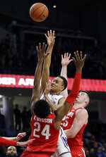 Northwestern forward A.J. Turner, center, shoots between Ohio State forwards Andre Wesson, left, and Kyle Young during the second half of an NCAA college basketball game Wednesday, March 6, 2019, in Evanston, Ill. (AP Photo/Nam Y. Huh)