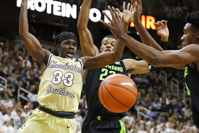 Charleston Southern guard Dontrell Shuler (33) loses control of the ball as Michigan State forward Xavier Tillman (23) defends during the first half of an NCAA college basketball game, Monday, Nov. 18, 2019, in East Lansing, Mich. (AP Photo/Carlos Osorio)