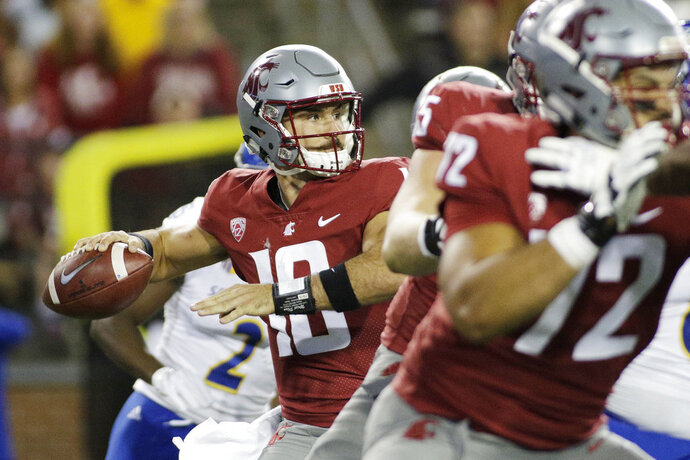 Washington State quarterback Gardner Minshew II, left, looks to pass during the first half of an NCAA college football game against San Jose State in Pullman, Wash., Saturday, Sept. 8, 2018. (AP Photo/Young Kwak)