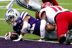 Kansas State running back Deuce Vaughn gets past Arkansas State linebacker Jaden Harris (11) to score a touchdown during the first half of an NCAA college football game Saturday, Sept. 12, 2020, in Manhattan, Kan. (AP Photo/Charlie Riedel)