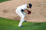 Minnesota Twins pitcher Hansel Robles celebrates the final out as the Twins defeated the Chicago White Sox in a baseball game Monday, July 5, 2021, in Minneapolis. (AP Photo/Jim Mone)