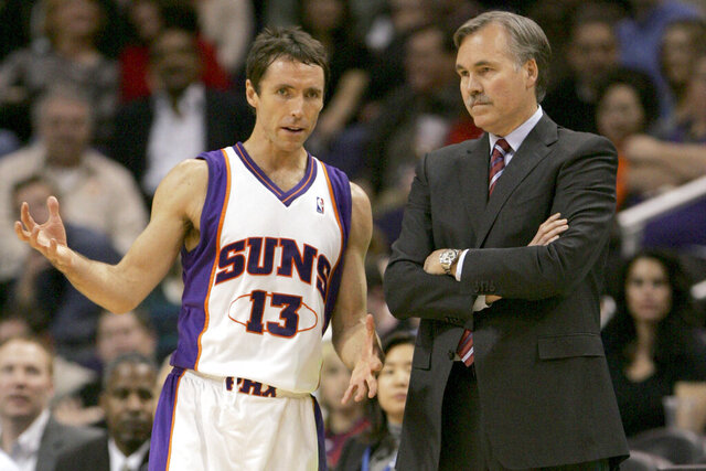 FILE - In this Feb. 6, 2008, file photo, Phoenix Suns guard Steve Nash, left, talks with head coach Mike D'Antoni during the third quarter of an NBA basketball game against the New Orleans Hornets in Phoenix. D'Antoni and Amare Stoudemire are joining Nash's coaching staff, bringing a glimpse of the old Phoenix Suns to Brooklyn. Nash hired his old coach and pick-and-roll partner as assistants Friday, Oct. 30, 2020, filling out his staff for his rookie season as an NBA coach. (AP Photo/Matt York, File)