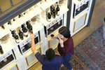 People tastes wines from a dispensary at the Oakville Wine Merchant Friday, June 12, 2020, in Oakville, Calif. California wineries started uncorking their bottles and welcoming people back to their tasting rooms Friday as the state's $145 billion tourism industry gears up with hotels, zoos, museums and aquariums also allowed to reopen. The wine retail experience in Oakville features 50 different wines by the taste or glass and is open to the public without an appointment. (AP Photo/Eric Risberg)