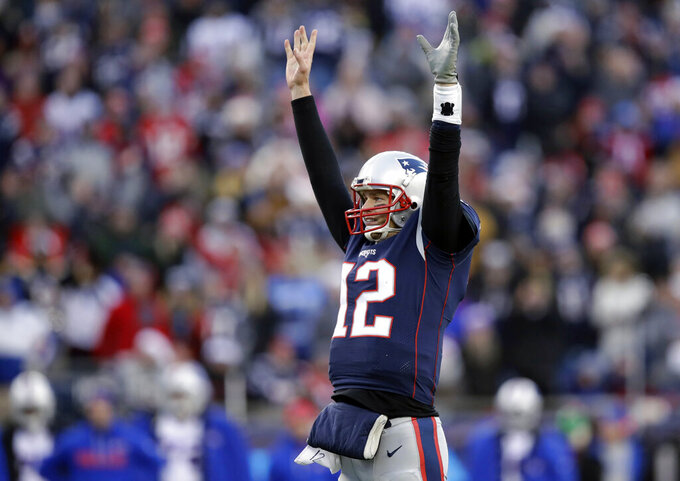 FILE - In this Dec. 24, 2017, file photo, New England Patriots quarterback Tom Brady celebrates a touchdown by running back Dion Lewis during the second half of the team's NFL football game against the Buffalo Bills in Foxborough, Mass. Brady's .774 regular season winning percentage ranks first in the Super Bowl era among quarterbacks with at least 50 starts. With 249 victories overall, including playoffs, he's won almost as many games in two decades as the Tampa Bay Buccaneers have won (273) in the franchise's 44-season history. (AP Photo/Charles Krupa, File)