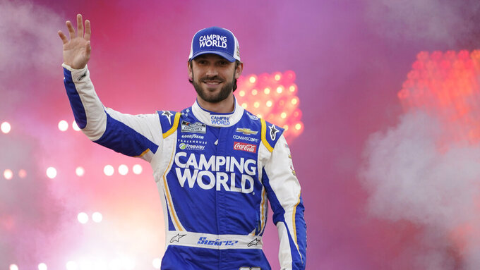 Daniel Suarez waves to the crowd during driver introductions prior to the start of the NASCAR Cup series auto race in Richmond, Va., Saturday, Sept. 11, 2021. (AP Photo/Steve Helber)