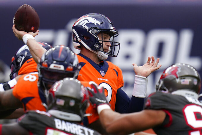 Denver Broncos quarterback Jeff Driskel throws a pass during the first half of an NFL football game against the Tampa Bay Buccaneers, Sunday, Sept. 27, 2020, in Denver. (AP Photo/Jack Dempsey)