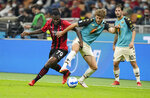 Venezia's Tanner Tessmann, right, challenges for the ball with AC Milan's Franck Kessie during the Serie A soccer match between AC Milan and Venezia at the San Siro stadium, in Milan, Italy, Wednesday, Sept. 22, 2021. Italian soccer team Venezia is back in the top division for the first time since 2002. And it has tapped Major League Soccer to recruit young Americans in its bid to stay afloat in Serie A. Nineteen-year-old Gianluca Busio arrived in Venice from Sporting Kansas City and 20-year-old Tanner Tessmann from FC Dallas. (AP Photo/Antonio Calanni)
