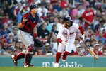 Boston Red Sox's Jack Lopez, right, runs on his sacrifice bunt in front of Cleveland Indians' Ryan Lavarnway during the seventh inning of a baseball game, Saturday, Sept. 4, 2021, in Boston. (AP Photo/Michael Dwyer)
