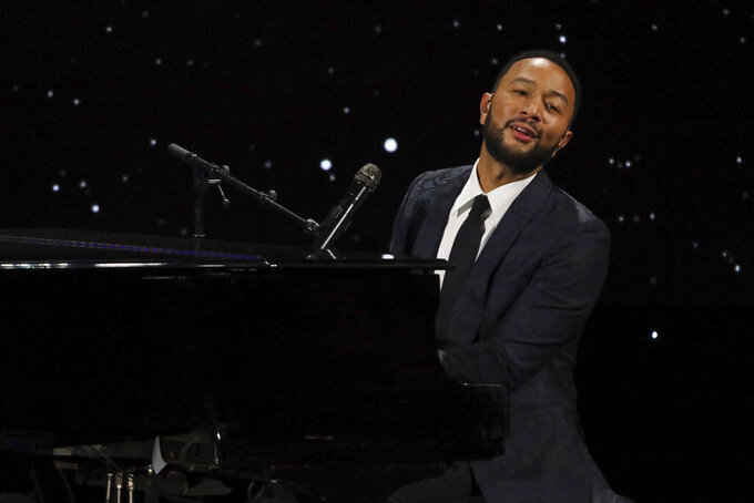 """FILE - John Legend performs live on stage at The Alliance for Children's Rights 28th Annual Dinner on March 5, 2020, in Beverly Hills, Calif. Legend dedicated his performance of """"Never Break"""" at the Billboard Music Awards, aired Wednesday, Oct. 14, 2020, to his wife Chrissy Teigen, who recently announced she had a miscarriage. (Photo by Willy Sanjuan/Invision/AP, File)"""