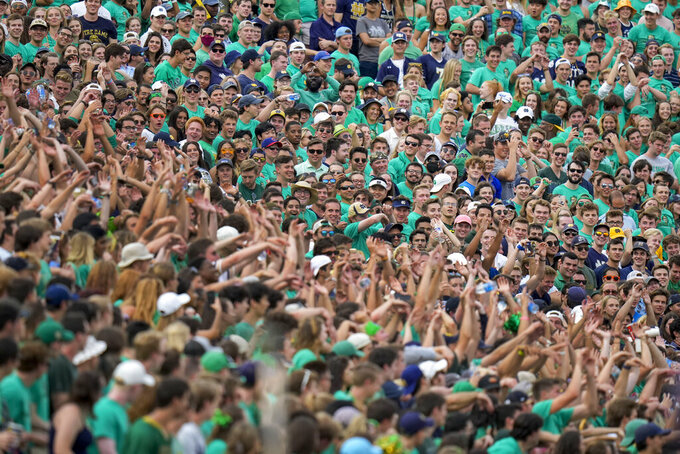 """Fans watch as """"the wave"""" goes around Notre Dame Stadium in the second half of an NCAA college football game between Toledo and Notre Dame in South Bend, Ind., Saturday, Sept. 11, 2021. Notre Dame won 32-29. (AP Photo/AJ Mast)"""