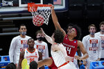Rutgers guard Ron Harper Jr. (24) dunks on Clemson forward PJ Hall (24) during the first half of a men's college basketball game in the first round of the NCAA tournament at Bankers Life Fieldhouse in Indianapolis, Friday, March 19, 2021. (AP Photo/Paul Sancya)
