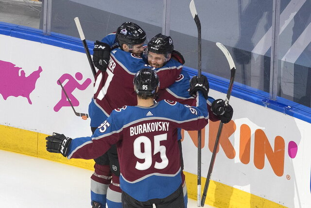 Colorado Avalanche' J.T. Compher (37), Tyson Jost (17) and Andre Burakovsky (95) celebrate a goal against the Arizona Coyotes during the second period of a first round NHL Stanley Cup playoff hockey series in Edmonton, Alberta, Friday, Aug. 14, 2020. (Jason Franson/The Canadian Press via AP)