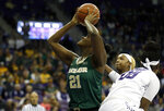 Baylor center Kalani Brown (21) looks to shoot after getting past TCU forward Amy Okonkwo (00) during the first half of an NCAA college basketball game Saturday, Jan. 12, 2019, in Fort Worth, Texas. (AP Photo/Ron Jenkins)