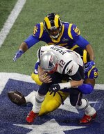 New England Patriots' Tom Brady fumbles as he is tackled by Los Angeles Rams' John Franklin-Myers (94) and Ethan Westbrooks (95) during the first half of the NFL Super Bowl 53 football game Sunday, Feb. 3, 2019, in Atlanta. (AP Photo/Charlie Riedel)