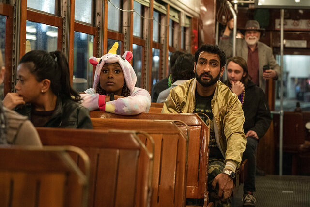 This image released by Netflix shows Issa Rae as Leilani, left, and Kumail Nanjiana as Jibran in a scene from