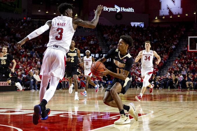 Purdue guard Isaiah Thompson (11) dribbles around Nebraska guard Cam Mack (3) for a layup during the second half of an NCAA college basketball game in Lincoln, Neb., Sunday, Dec. 15, 2019. (AP Photo/John Peterson)