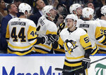 Pittsburgh Penguins center Jake Guentzel (59) celebrates with the bench after his goal against the Tampa Bay Lightning during the second period of an NHL hockey game Wednesday, Oct. 23, 2019, in Tampa, Fla. (AP Photo/Chris O'Meara)
